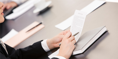 Image of person reviewing document