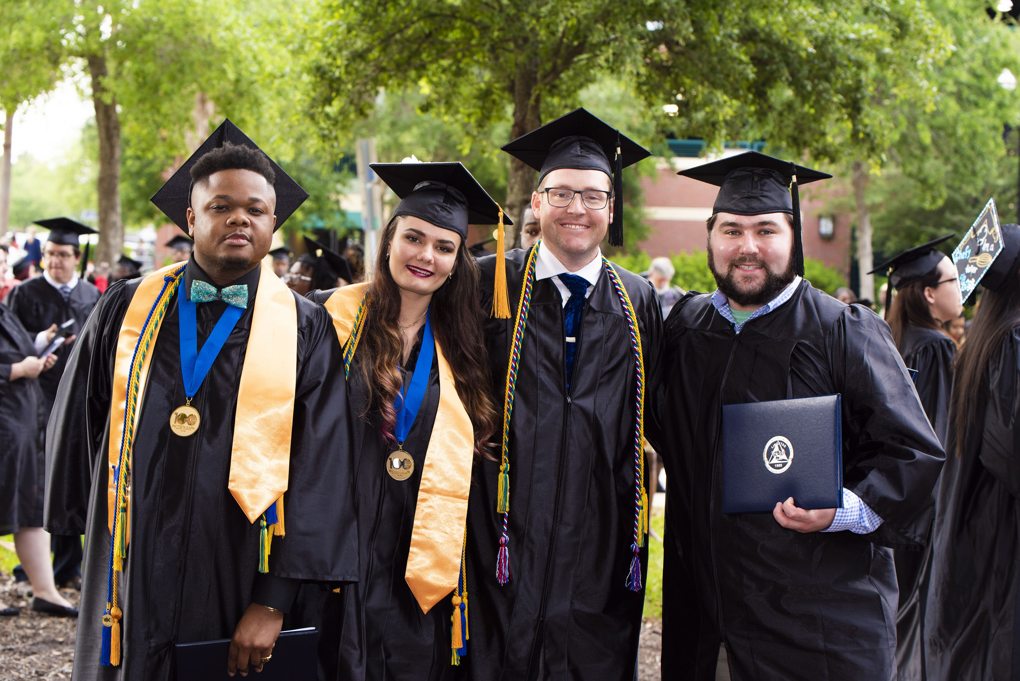 Commencement 2018 Group of four alumni